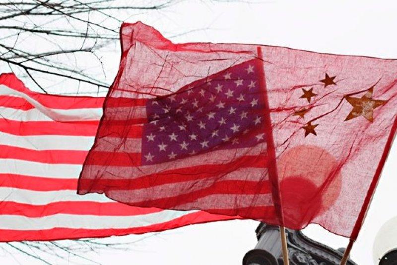 中國26日出版《美國全球監聽行動紀錄》報告,指控美國的監控行動超越國安需求。(美聯社)