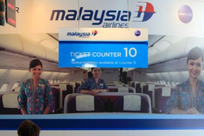 吉隆坡國際機場的馬來西亞航空公司櫃台。(美聯社)