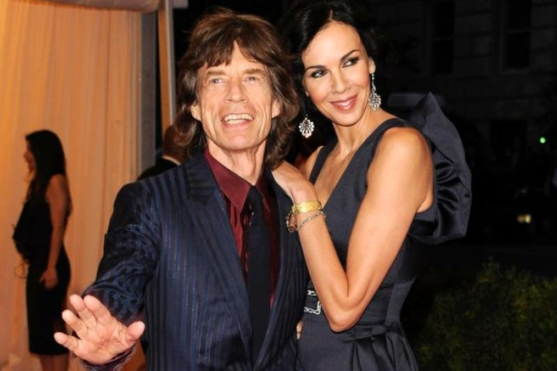 米克傑格和女友倫恩.史考特2012年5月7日在紐約的恩愛合照。(美聯社)