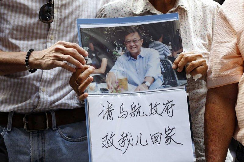 馬航MH370客機失事1周年,家屬仍然拒絕放棄希望。(美聯社)