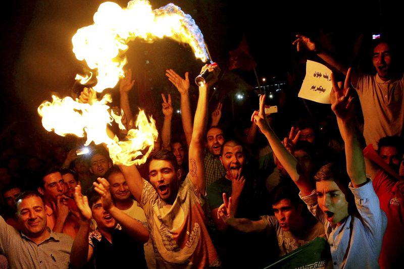 伊朗核子協議達陣,經濟制裁可望解除,民眾歡欣鼓舞。(美聯社)
