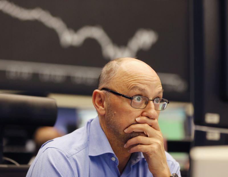 美國股市交易員24日望盤興嘆。(美聯社)