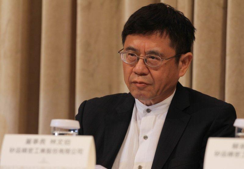 Q矽品董事長林文伯出席法說會。(葉信菉攝).JPG