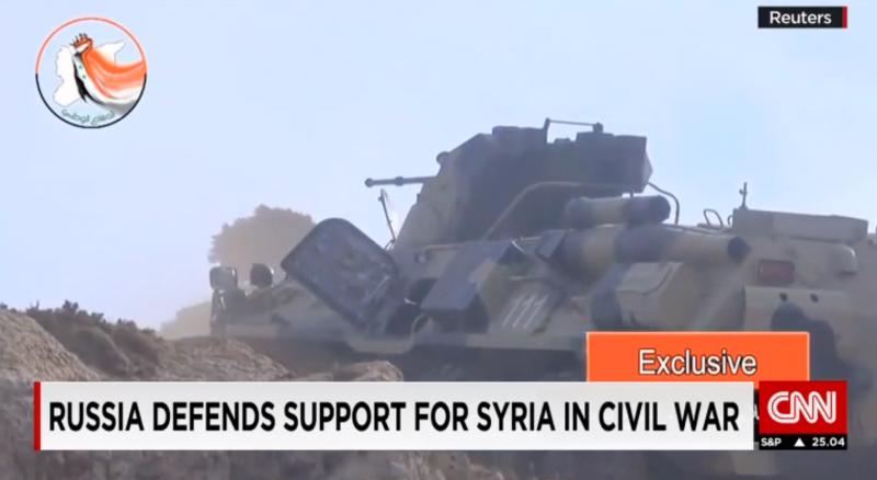 俄軍裝甲部隊出現在敘利亞國營電視台的畫面上。(翻攝CNN)