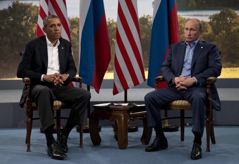 普京與歐巴馬於2013年6月會面,兩人相敬如「冰」。(美聯社)
