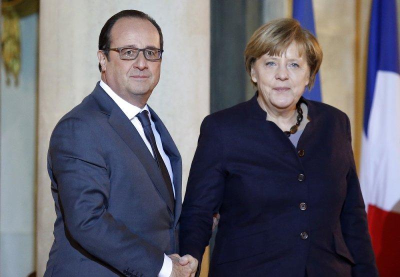 德國總理梅克爾(右)及法國總統奧朗德(左)(美聯社)