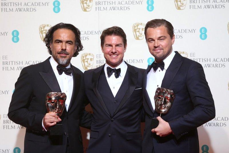 (左至右)最佳導演獲獎人阿利安卓崗札雷伊納利圖、演員湯姆克魯斯、最佳男演員獲獎人李奧納多狄卡皮歐(美聯社)