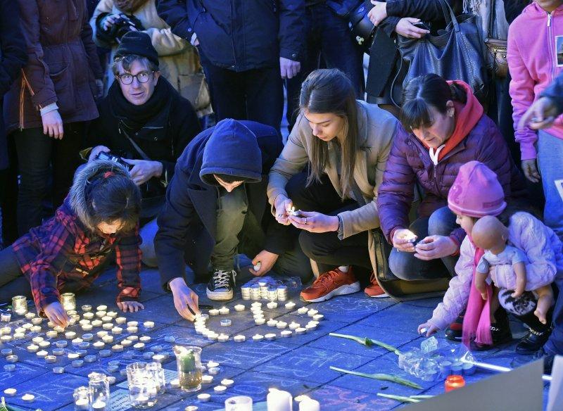 比利時民眾為布魯塞爾恐攻遇襲者哀悼(美聯社)
