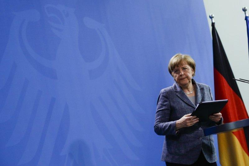 德國總理梅克爾15日發表聲明後準備離席(美聯社)