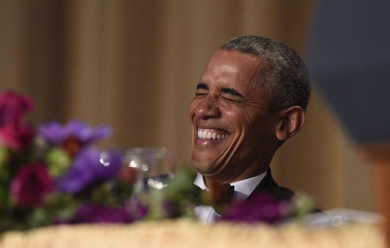 歐巴馬表情誇張。(美聯社)