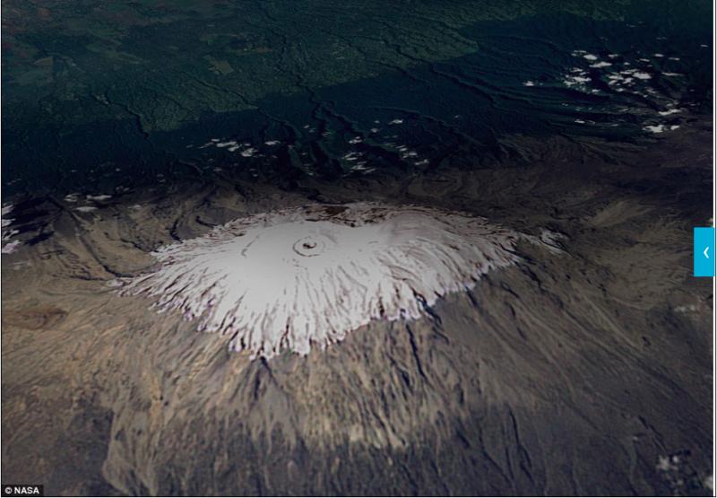 位於坦尚尼亞的非洲最高峰,頂部是雪白的冰原。(圖/NASA)