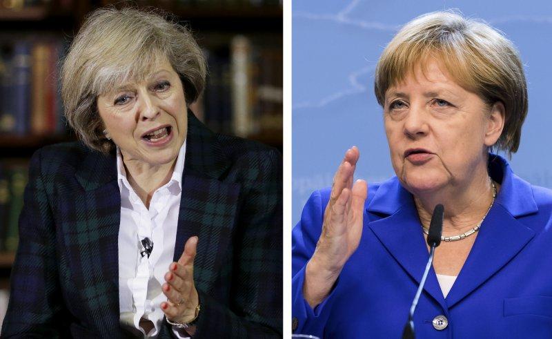 英國新任首相梅伊(Theresa May)與德國總理梅克爾(Angela Merkel)(美聯社)
