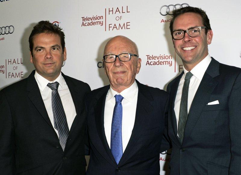 21世紀福斯與新聞集團主席梅鐸,及其兩位同任高層的兒子。(美聯社)