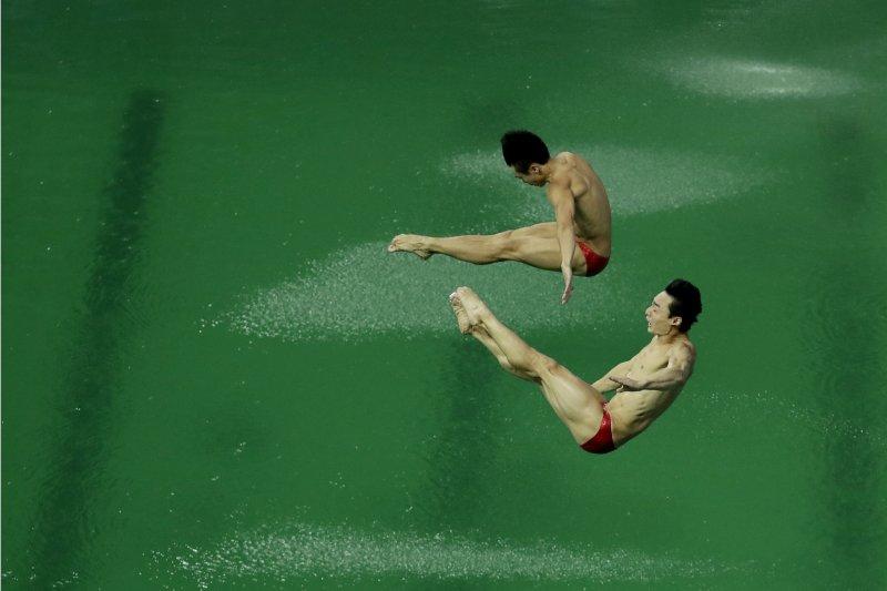 里約奧運跳水男雙3公尺跳板賽,中國沒能衛冕僅摘銅。(美聯社)