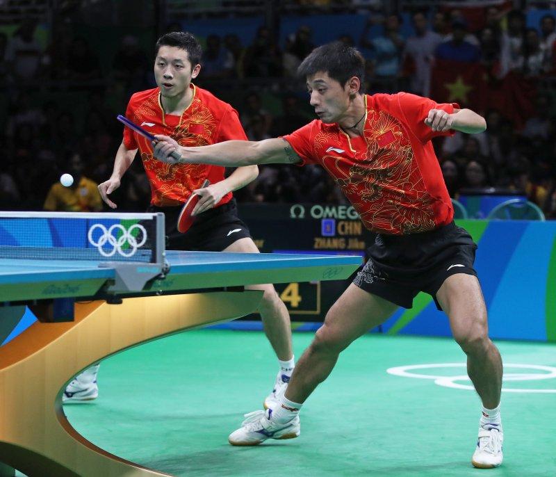 中國桌球男子團體賽奪金,達成奧運所有桌球項目3連霸。(美聯社)