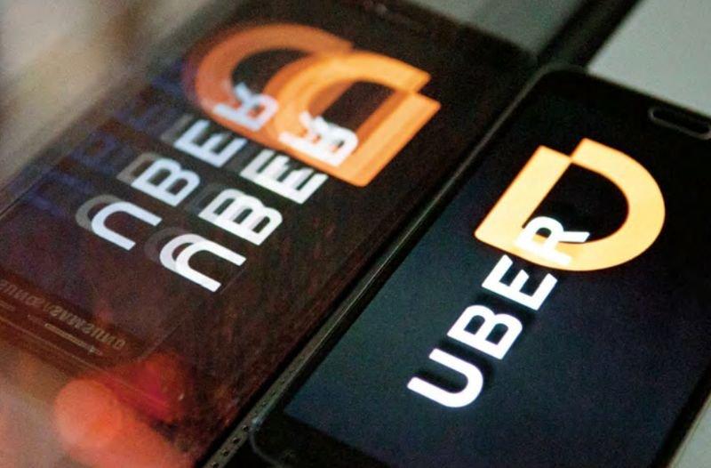 滴滴出行(Didi Chuxing)與優步(Uber Technologies)全球達成戰略協議。(來源:東方IC/多維提供)