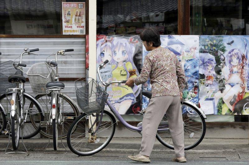 埼玉縣鷲宮神社因漫畫作品《幸運星》成為觀光景點,神社附近充滿漫畫元素。(美聯社)