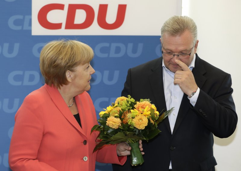 基民盟地方選舉慘敗,梅克爾表示作為黨主席她自有責任。(美聯社)
