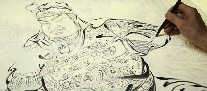佛畫的創作,不論是一筆一畫,都講究精氣神的合一。(圖取自Youtube)
