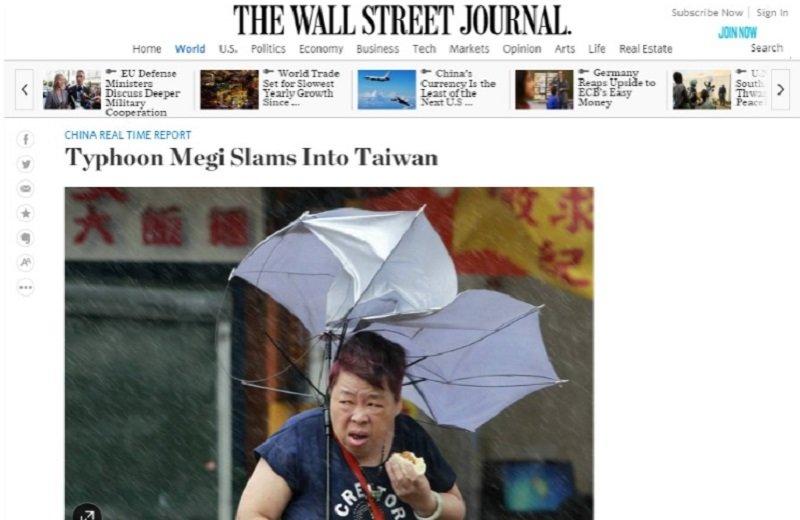 風雨中吃肉包的婦人登上《華爾街日報》。(網站截圖)