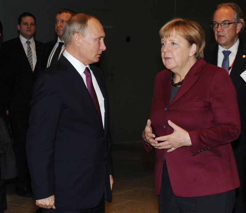 俄羅斯總統普京與德國總理梅克爾商議敘利亞局勢。(美聯社)
