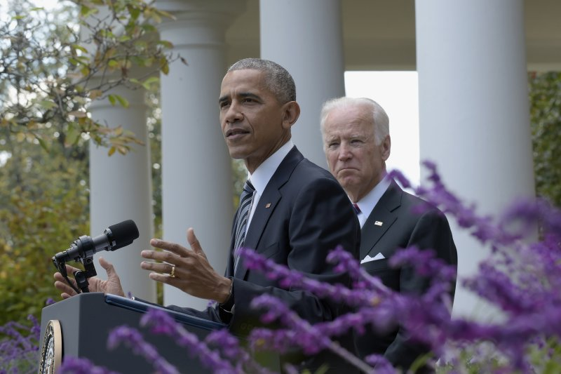 美國總統歐巴馬與副總統拜登9日對大選發表談話。(美聯社)