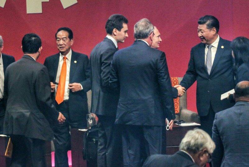 2016-11-20-宋楚瑜出使APEC-與各國代表會面-中華台北代表團提供