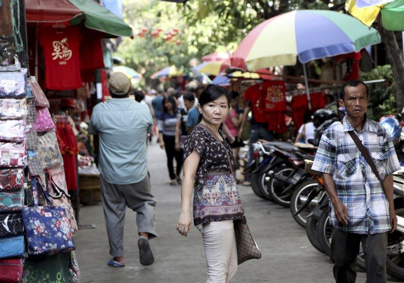 華人佔印尼人口不到5%,但經濟普遍較其他族裔優渥,常常在暴動中受到攻擊。(美聯社)
