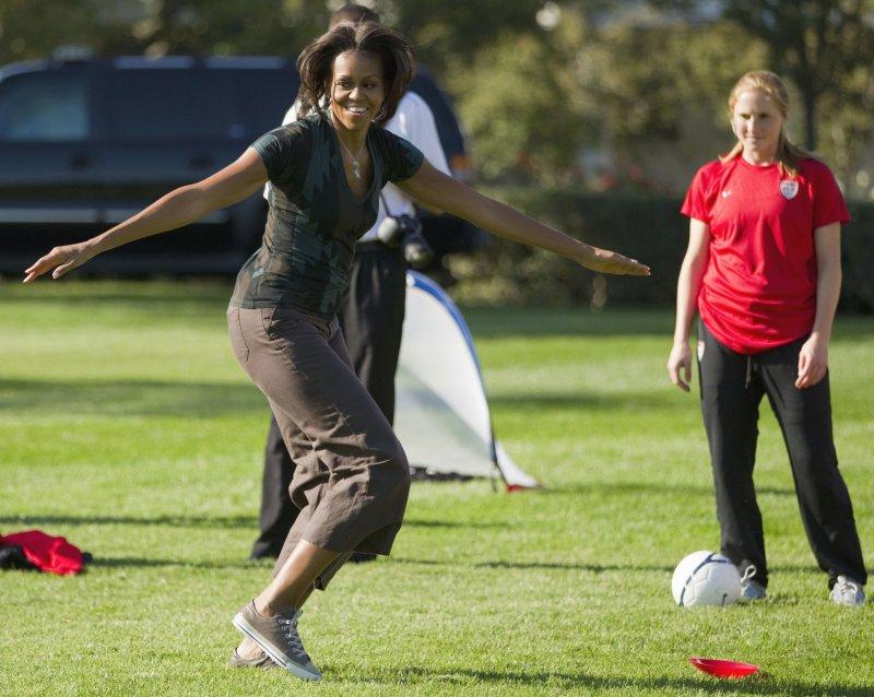 為對抗兒童肥胖問題,蜜雪兒發起「一起動一動」行動,邀請兒童和她一同運動。(美聯社)