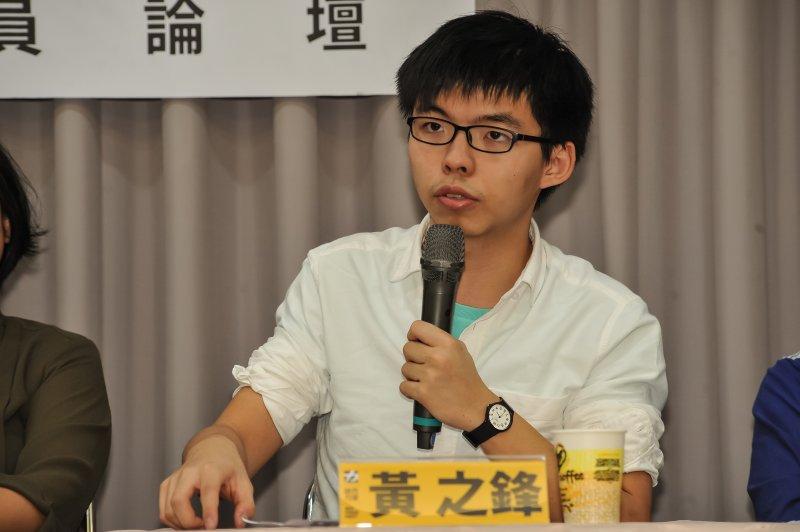 香港眾志秘書長黃之鋒等人受邀參加時代力量舉辦的台港議員論壇交流。(甘岱民攝)