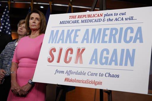 抗議共和黨廢除歐巴馬健保預算的民眾。(美聯社)