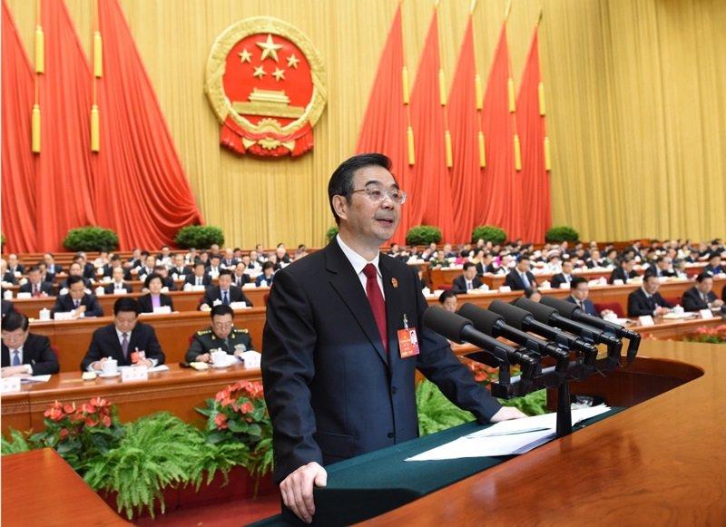 周強在中國十二屆人大報告司法院工作。(資料照/新華社)