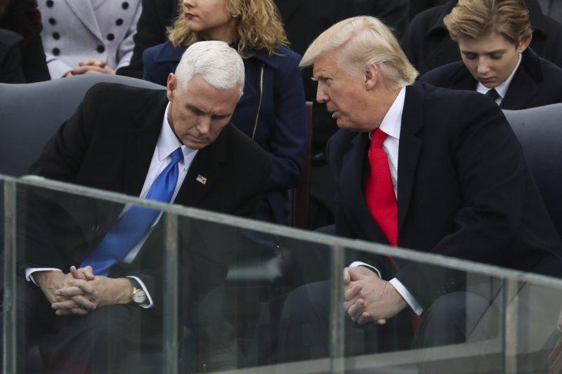 美國新任正副總統川普與彭斯。(美聯社)