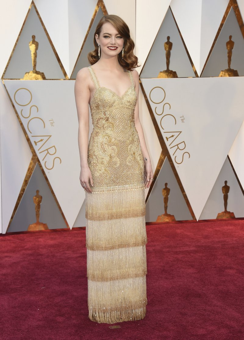艾瑪史東以《樂來越愛你》榮獲最佳女主角獎。(美聯社)