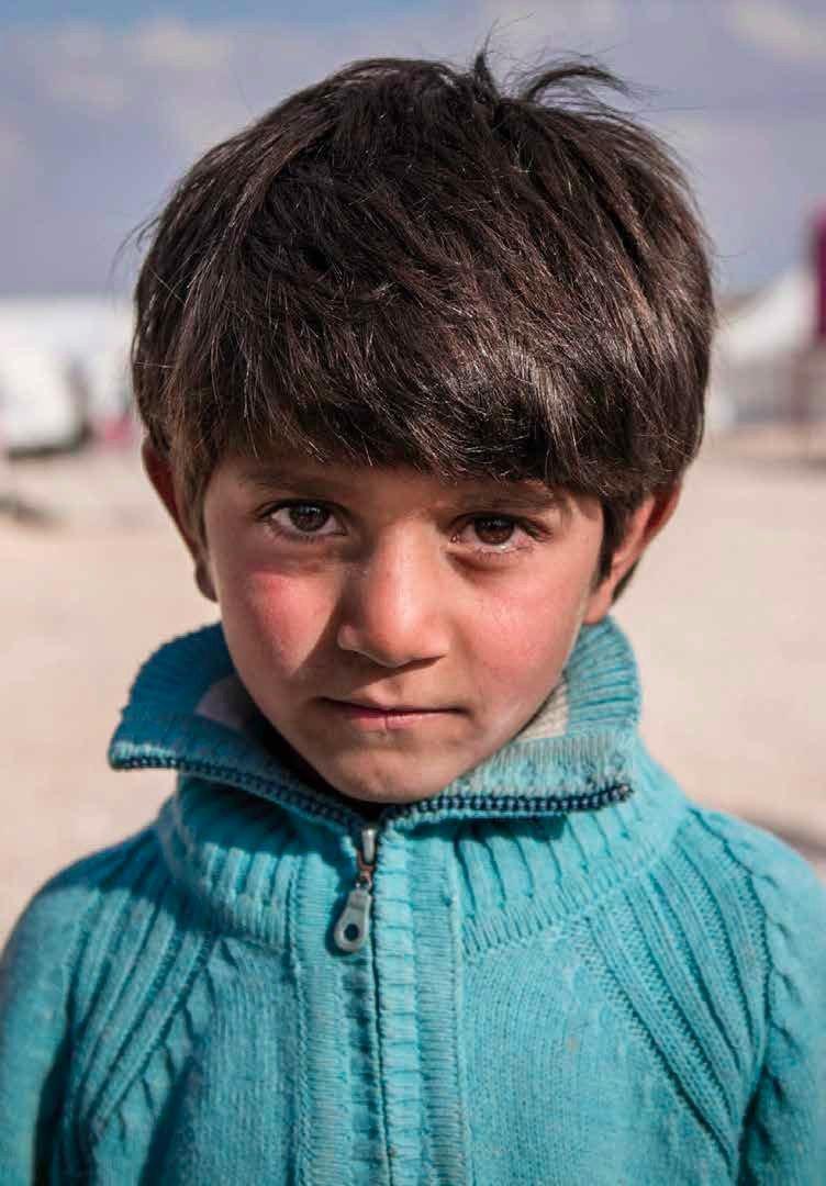 7歲的敘利亞男童伊伯拉罕希望能回學校唸書,他的爸爸擔心缺乏教育會影響到他的未來。(圖取自Save the Children)