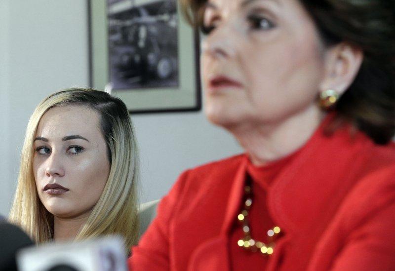 美國海軍爆發女兵裸照醜聞,受害者在律師陪同下出面指控。(AP)