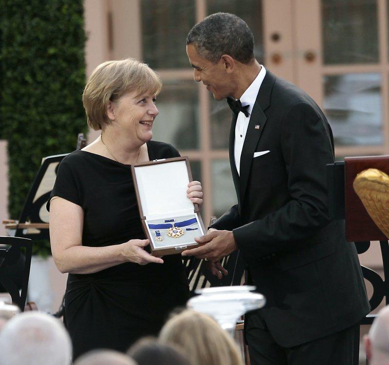 美國前總統歐巴馬(右)與德國總理梅克爾(左)私交甚篤(AP)