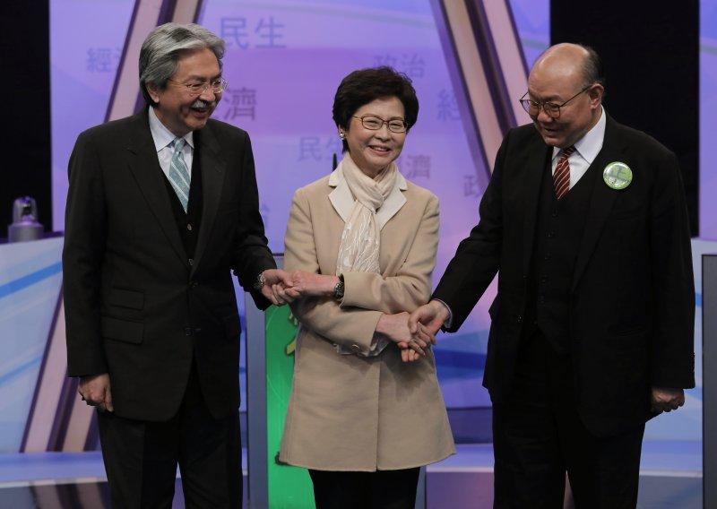 香港特首選舉三位候選人,由左而右分別為曾俊華、林鄭月娥和胡國興。(美聯社)
