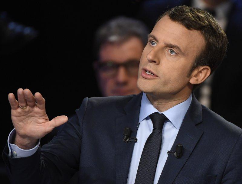 年僅39歲的中間派候選人馬克宏整體民調領先,辯論表現也高居第二。(美聯社)