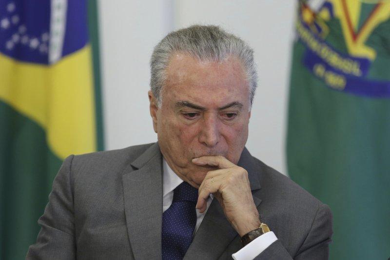 抗議政府上修退休年齡,巴西多城市發動百萬人大罷工。巴西總統特梅爾。(美聯社)