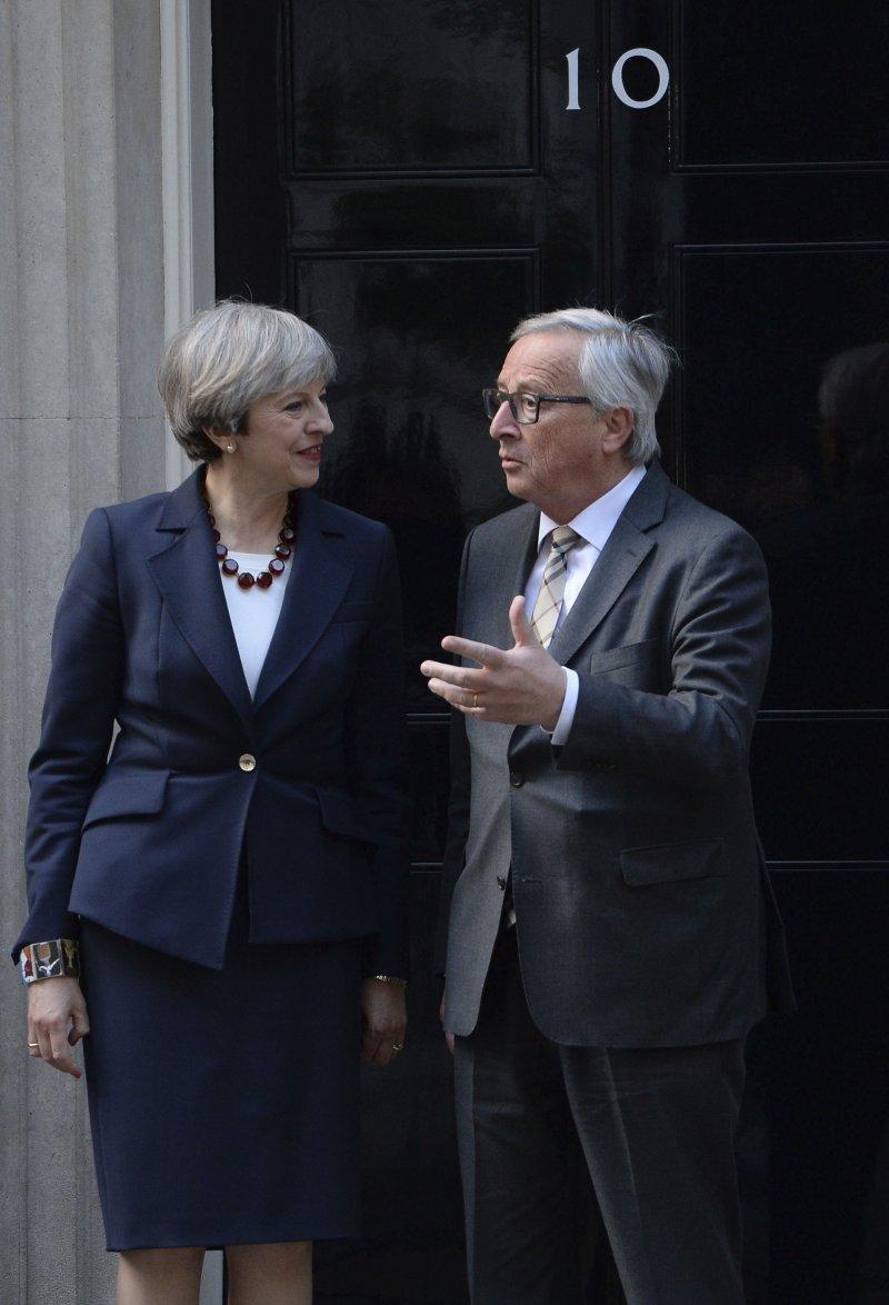 英國首相梅伊與歐盟執委會主席容克(AP)