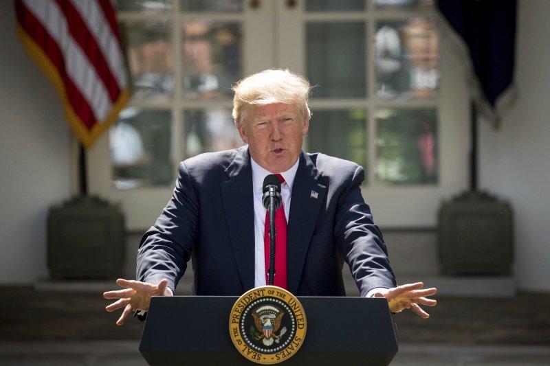 美國總統川普宣布,將退出推動溫室氣體排放減量、遏阻全球暖化的《巴黎協定》。(美聯社)