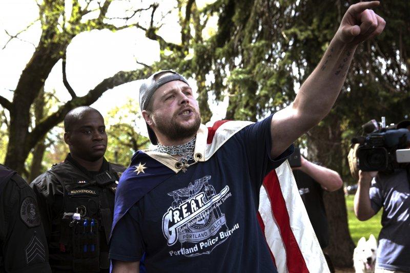 日前殺死三名路人的兇手克里斯蒂安,曾參加極右派集會被拍下。(美聯社)