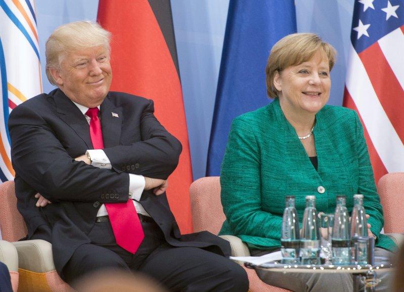美國總統川普在女企業家財政會議上誇讚德國總理梅克爾(AP)