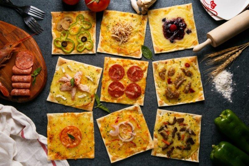 正方形的薄脆餅皮是披薩市Pizza Rice的招牌(圖片來源:披薩市Pizza Rice)