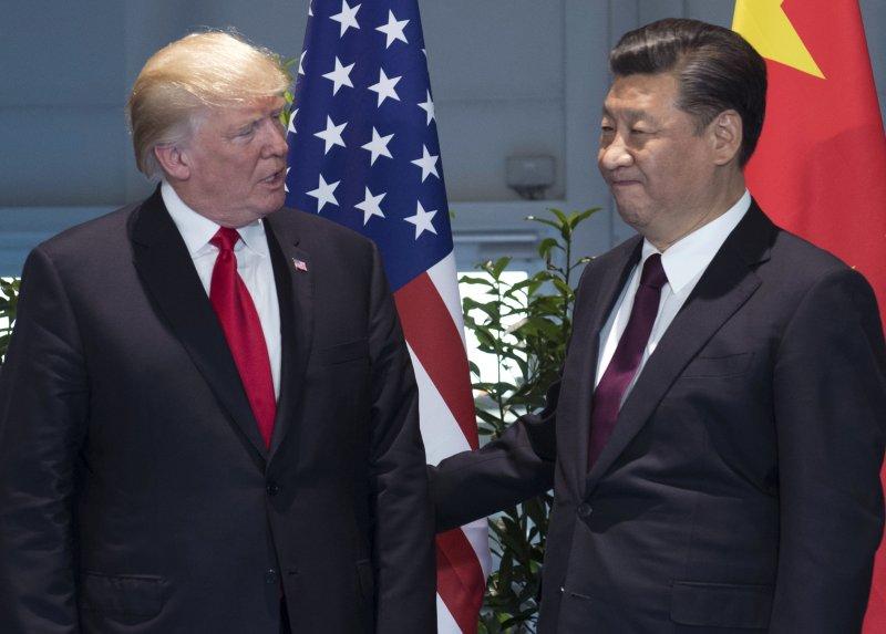 美中貿易戰是否開打?對中國經濟有何衝擊?舉世關注。川普與習近平(AP)