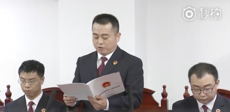2017-09-11-中國對李明哲展開審判,檢方宣讀起訴書。(取自官方微博)