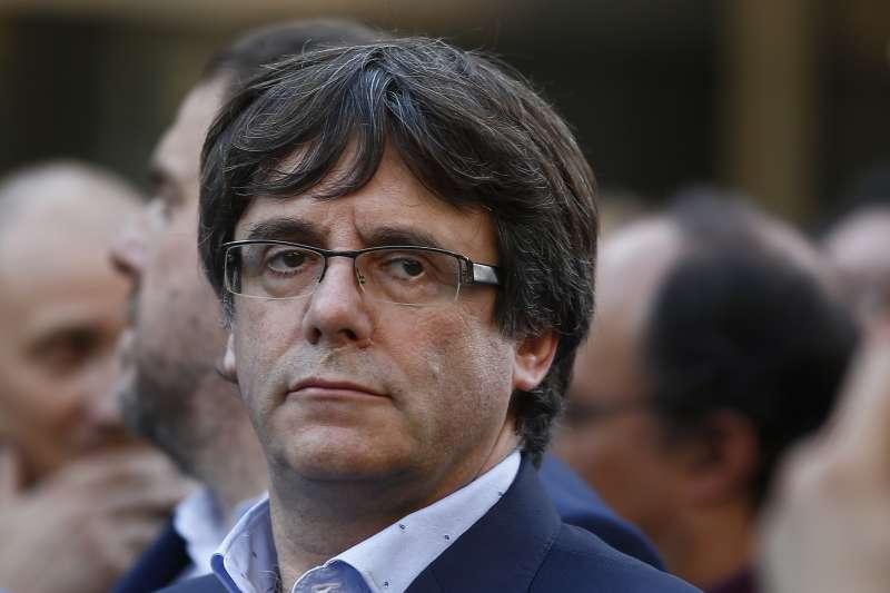 加泰隆尼亞自治區主席普吉德蒙,表示加泰隆尼亞人民不會接受解散自治政府的決定。(美聯社)