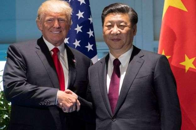 川普與習近平七月在德國舉行的七國集團(G7)峰會見面。(BBC中文網)