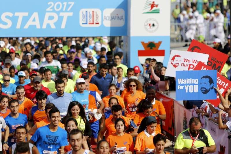 黎巴嫩民眾舉辦路跑活動,聲援總理哈里里,期盼他盡快回國。(美聯社)
